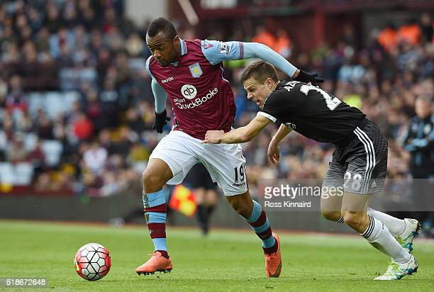 Jordan Ayew of Aston Villa and Cesar Azpilicueta of Chelsea compete for the ball during the Barclays Premier League match between Aston Villa and...