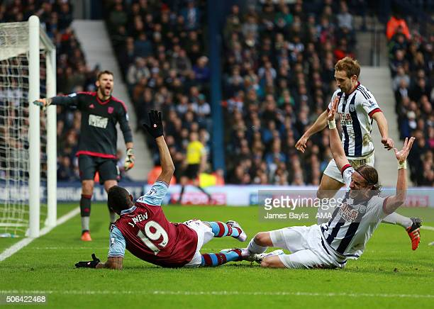 Jordan Ayew of Aston Villa appeals for a penalty after this challenge from Jonas Olsson of West Bromwich Albion during the Barclays Premier League...