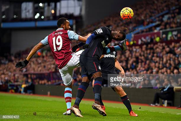 Jordan Ayew of Aston Villa battles for the ball with Pedro Mba Obiang of West Ham United during the Barclays Premier League match between Aston Villa...