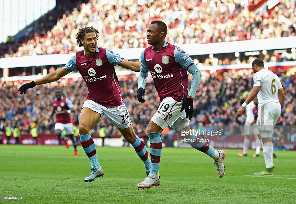 Jordan Ayew (R) of Aston Villa celebrates scoring his team's first goal with Rudy Gestede (L) during the Barclays Premier League match between Aston Villa and Swansea City at Villa Park on October 24, 2015 in Birmingham, England.