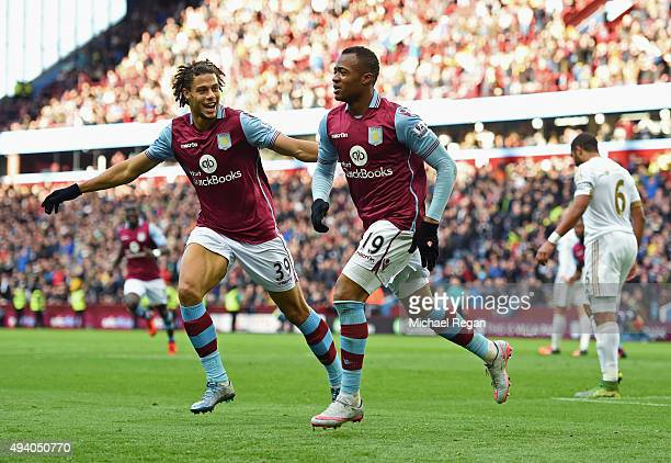 Jordan Ayew of Aston Villa celebrates scoring his team's first goal with Rudy Gestede during the Barclays Premier League match between Aston Villa...