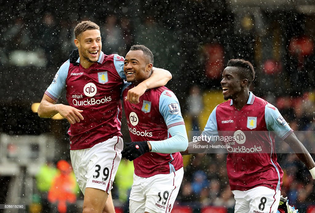 Jordan Ayew (C) of Aston Villa celebrates scoring his team's second goal with his team mates Rudy Gestede (L) and Idrissa Gueye (R) during the Barclays Premier League match between Watford and Aston Villa at Vicarage Road on April 30, 2016 in Watford, England.