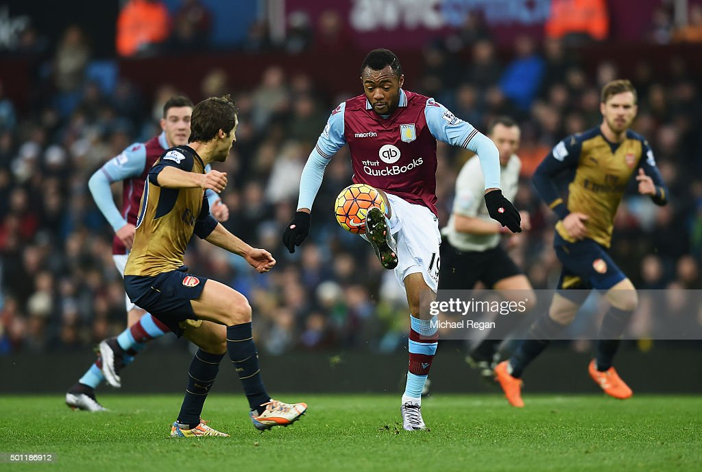 Jordan Ayew of Aston Villa controls the ball under pressure from Mathieu Flamini of Arsenal during the Barclays Premier League match between Aston Villa and Arsenal at Villa Park on December 13, 2015 in Birmingham, England.