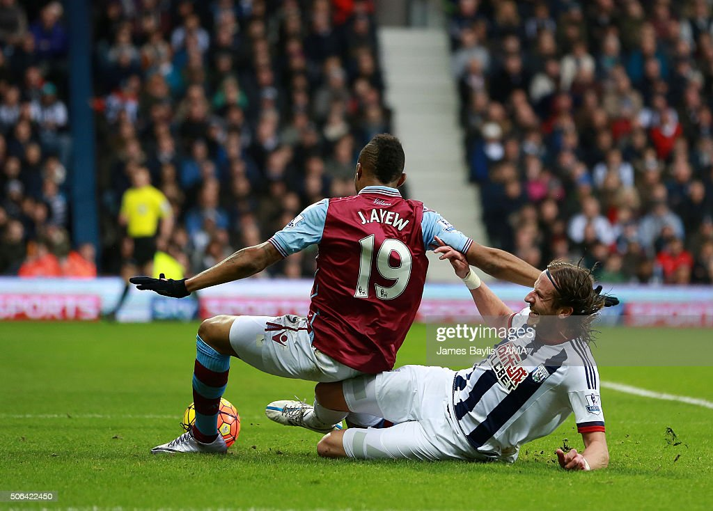 Jordan Ayew of Aston Villa is challenged by Jonas Olsson of West Bromwich Albion but no penalty is awarded during the Barclays Premier League match between West Bromwich Albion and Aston Villa at The Hawthorns on January 23, 2016 in West Bromwich, England.