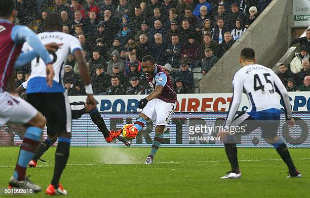 Jordan Ayew of Aston Villa scores his team's first goal during the Barclays Premier League match between Newcastle United and Aston Villa at St...