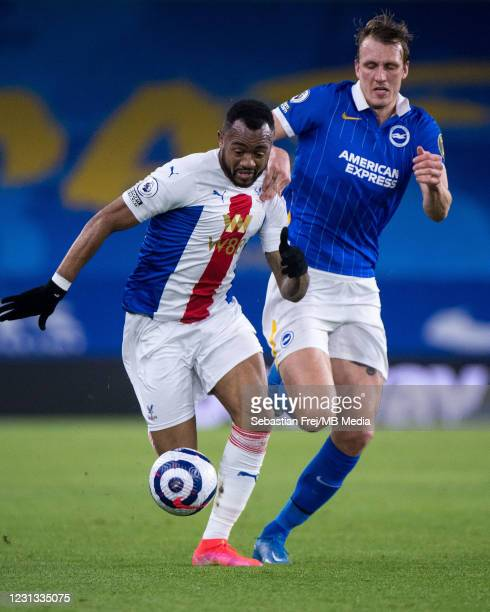 Jordan Ayew of Crystal Palace and Dan Burn of Brighton & Hove Albion in action during the Premier League match between Brighton & Hove Albion and...