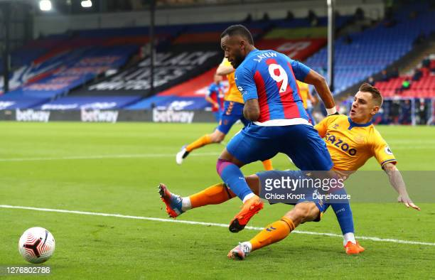 Jordan Ayew of Crystal Palace and Lucas Digne of Everton in action during the Premier League match between Crystal Palace and Everton at Selhurst...