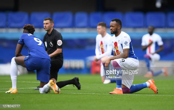 Jordan Ayew of Crystal Palace and Tammy Abraham of Chelsea take a knee in support of the black lives matter movement prior to the Premier League...