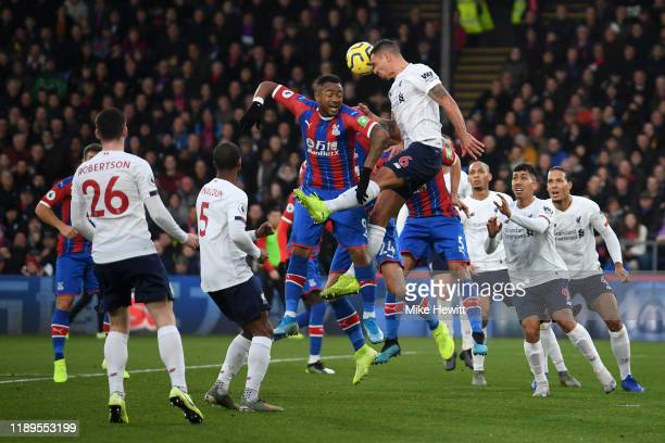 Jordan Ayew of Crystal Palace battles for possession with Dejan Lovren of Liverpool during the Premier League match between Crystal Palace and...