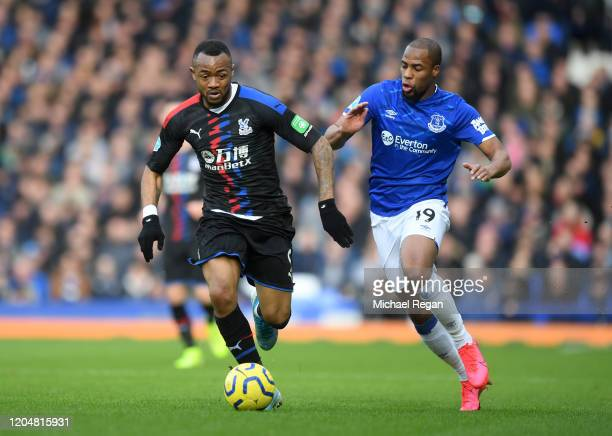 Jordan Ayew of Crystal Palace battles for possession with Djibril Sidibe of Everton during the Premier League match between Everton FC and Crystal...