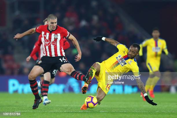 Jordan Ayew of Crystal Palace battles for possession with Oriol Romeu of Southampton during the Premier League match between Southampton FC and...