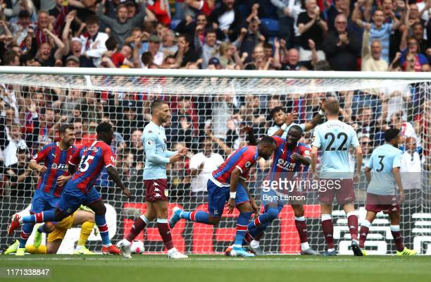 Jordan Ayew of Crystal Palace celebrates after scoring his team's first goal during the Premier League match between Crystal Palace and Aston Villa...