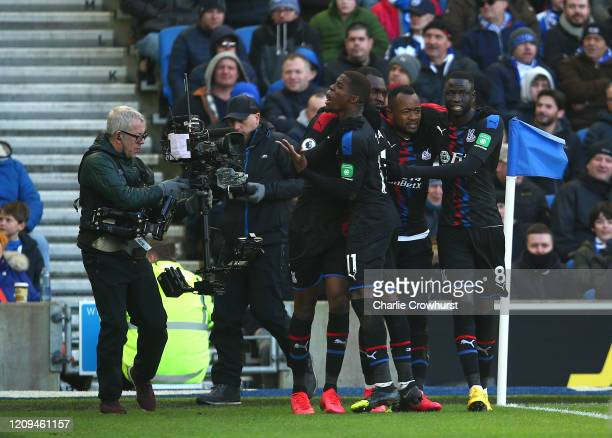 Jordan Ayew of Crystal Palace celebrates after scoring his team's first goal with team mates during the Premier League match between Brighton Hove...