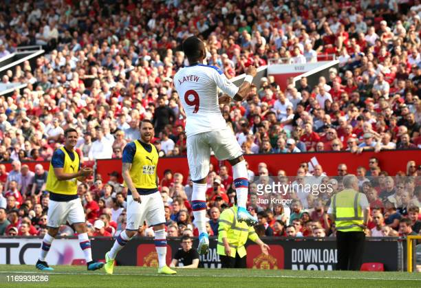 Jordan Ayew of Crystal Palace celebrates scoring the opening goal during the Premier League match between Manchester United and Crystal Palace at Old...