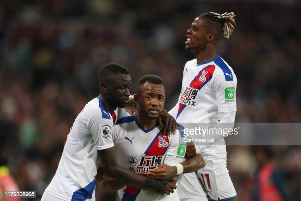 Jordan Ayew of Crystal Palace celebrates with his team mates after scoring his sides second goal which is awarded following a VAR review during the...