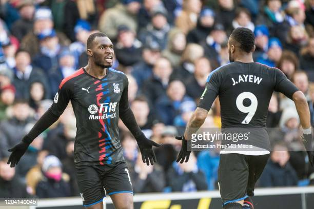 Jordan Ayew of Crystal Palace celebrates with team mate Christian Benteke after scoring goal during the Premier League match between Brighton Hove...
