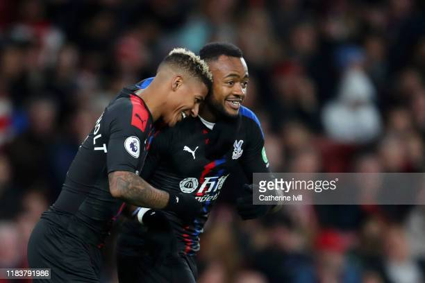 Jordan Ayew of Crystal Palace celebrates with team mate Patrick van Aanholt of Crystal Palace after scoring their team's second goal during the...