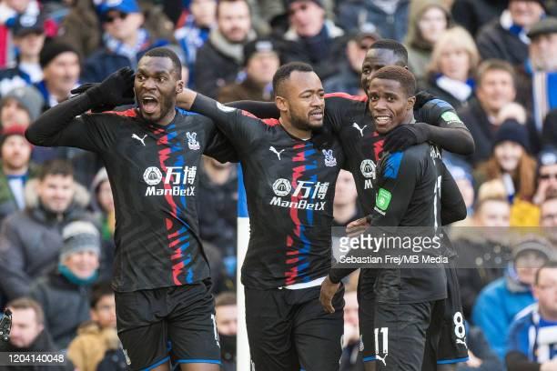 Jordan Ayew of Crystal Palace celebrates with team mates Wilfried Zaha Cheikhou Kouyaté and Christian Benteke after scoring goal during the Premier...