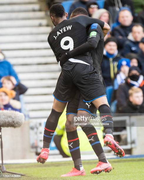 Jordan Ayew of Crystal Palace celebrates with teammate Christian Benteke after scoring the first goal of his team during the Premier League match...