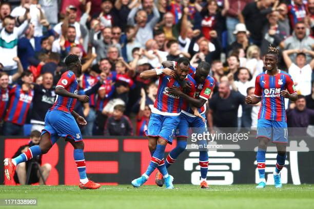 Jordan Ayew of Crystal Palace celebrates with teammates after scoring his team's first goal during the Premier League match between Crystal Palace...