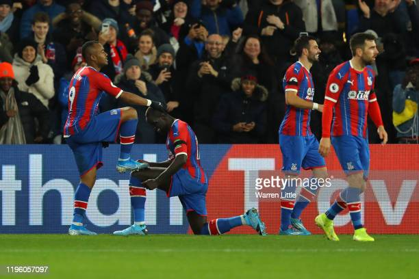 Jordan Ayew of Crystal Palace celebrates with teammates after scoring his sides second goal during the Premier League match between Crystal Palace...
