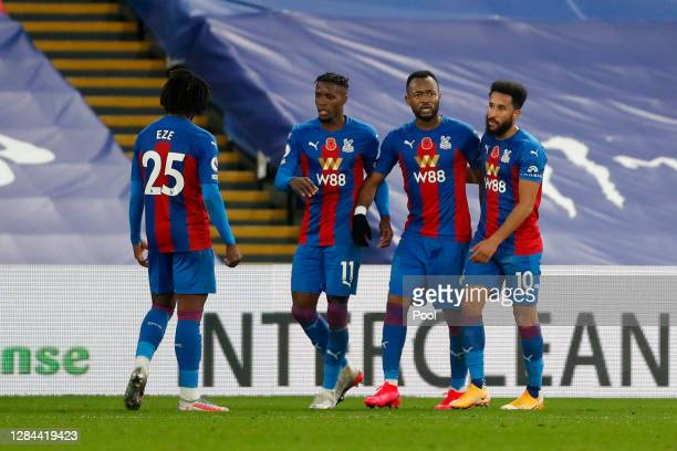 Jordan Ayew of Crystal Palace celebrates with teammates after scoring his team's fourth goal during the Premier League match between Crystal Palace...