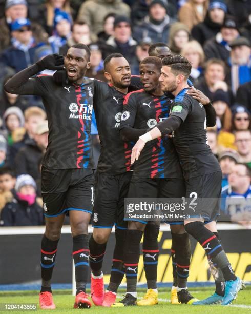 Jordan Ayew of Crystal Palace celebrates with teammates Wilfried Zaha Cheikhou Kouyaté Joel Ward and Christian Benteke after scoring goal the first...
