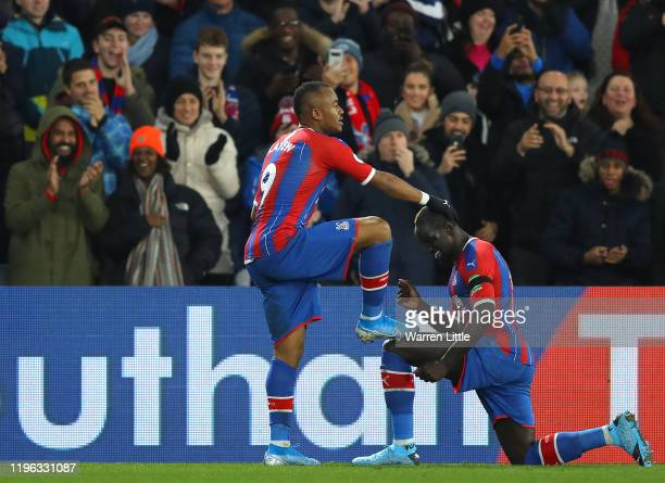 Jordan Ayew of Crystal Palace has his shoe polished by team mate Mamadou Sakho as they celebrate his goal during during the Premier League match...