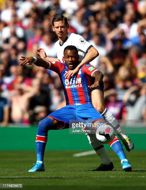 Jordan Ayew of Crystal Palace is challenged by Jan Vertonghen of Tottenham Hotspur during the Premier League match between Tottenham Hotspur and...