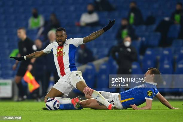 Jordan Ayew of Crystal Palace is fouled by Dan Burn of Brighton & Hove Albion during the Premier League match between Brighton & Hove Albion and...