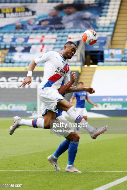 Jordan Ayew of Crystal Palace is tackled by a Leicester City player during the Premier League match between Leicester City and Crystal Palace at The...