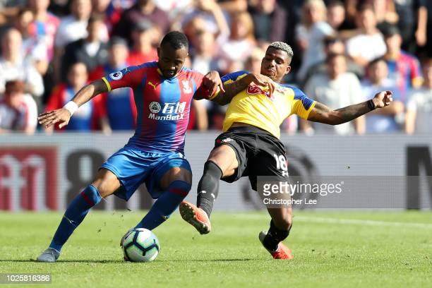 Jordan Ayew of Crystal Palace is tackled by Mario Lemina of Southampton during the Premier League match between Crystal Palace and Southampton FC at...