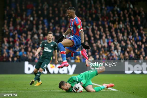 Jordan Ayew of Crystal Palace jumps over Martin Dubravka of Newcastle United during the Premier League match between Crystal Palace and Newcastle...