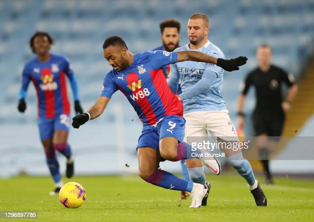 Jordan Ayew of Crystal Palace looks to break past Kyle Walker of Manchester City during the Premier League match between Manchester City and Crystal...