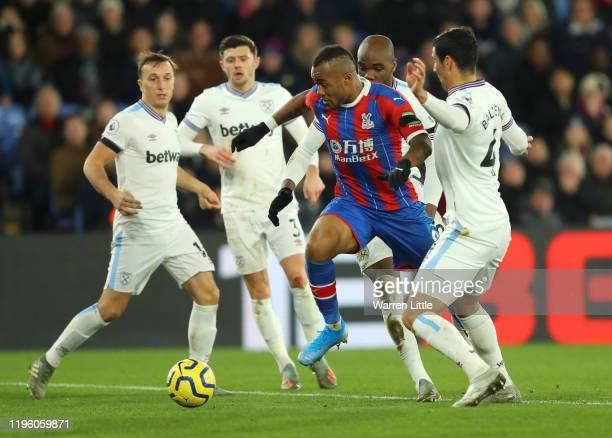 Jordan Ayew of Crystal Palace runs with the ball past Fabian Balbuena Angelo Ogbonna and Mark Noble of West Ham United on his way to scoring his...
