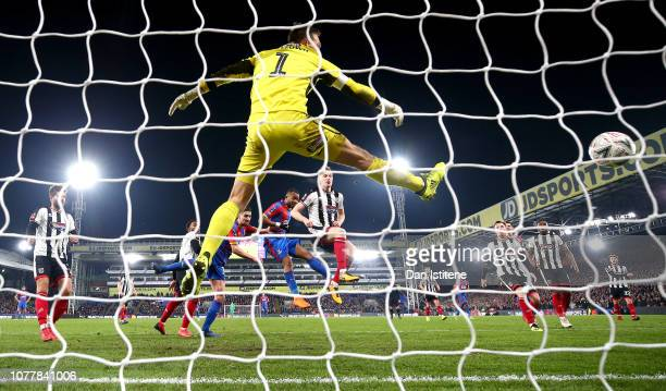 Jordan Ayew of Crystal Palace scores his team's first goal during the FA Cup Third Round match between Crystal Palace and Grimsby Town at Selhurst...
