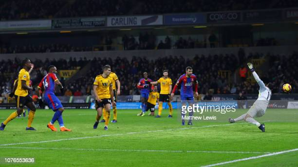 Jordan Ayew of Crystal Palace scores his team's first goal past Rui Patricio of Wolverhampton Wanderers during the Premier League match between...