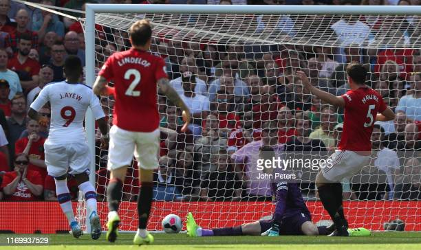 Jordan Ayew of Crystal Palace scores their first goal during the Premier League match between Manchester United and Crystal Palace at Old Trafford on...