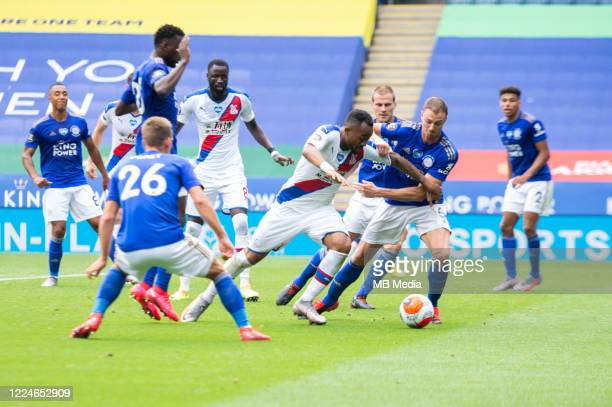 Jordan Ayew of Crystal Palace tries to find a way past Jonny Evans of Leicester City during the Premier League match between Leicester City and...