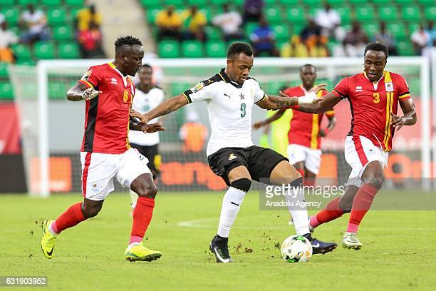 Jordan Ayew of Ghana vies for the ball against Geoffrey Kizito and Tonny Mawejje of Uganda during the African Cup of Nations 2017 Group D football...