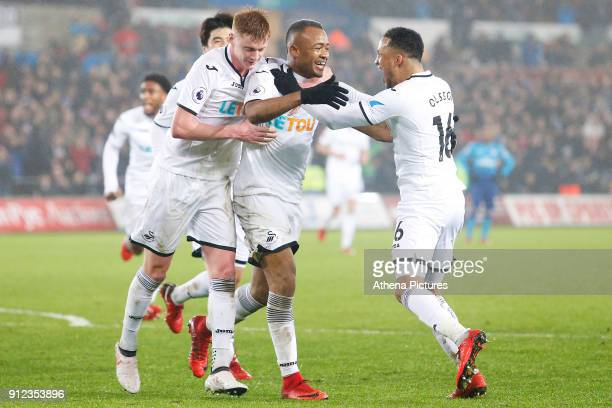 Jordan Ayew of Swansea celebrates scoring his sides second goal of the match with team mates Sam Clucas and Martin Olsson during the Premier League...