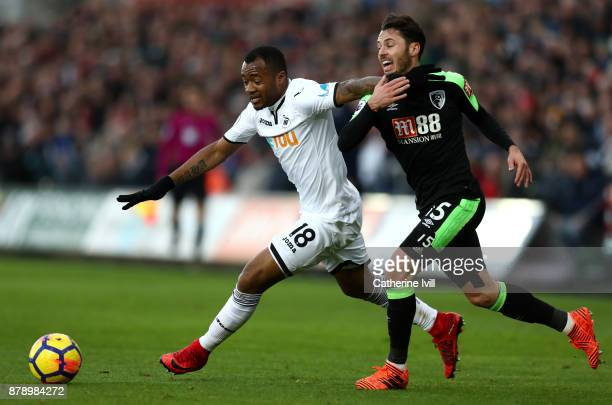 Jordan Ayew of Swansea City and Adam Smith of AFC Bournemouth battle for possession during the Premier League match between Swansea City and AFC...