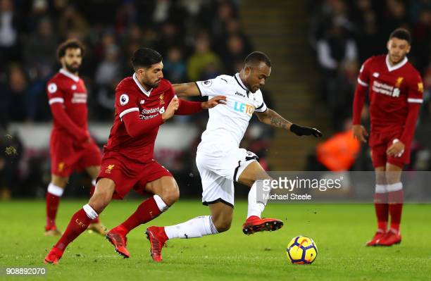 Jordan Ayew of Swansea City and Emre Can of Liverpool battle for possession during the Premier League match between Swansea City and Liverpool at...