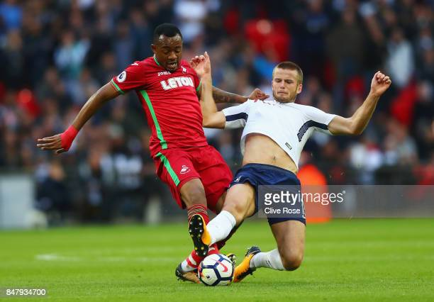 Jordan Ayew of Swansea City and Eric Dier of Tottenham Hotspur battle for possession during the Premier League match between Tottenham Hotspur and...