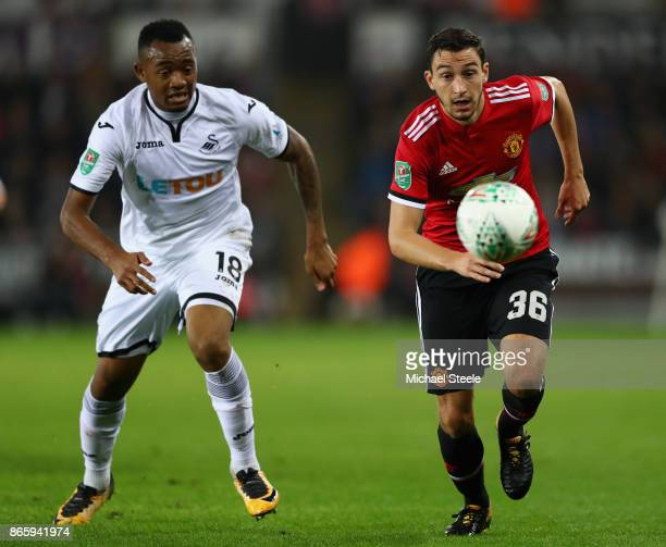 Jordan Ayew of Swansea City and Matteo Darmian of Manchester United in action during the Carabao Cup Fourth Round match between Swansea City and...