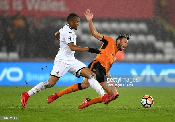 Jordan Ayew of Swansea City and Roderick Miranda of Wolverhampton Wanderers during The Emirates FA Cup Third Round Replay between Swansea City and...