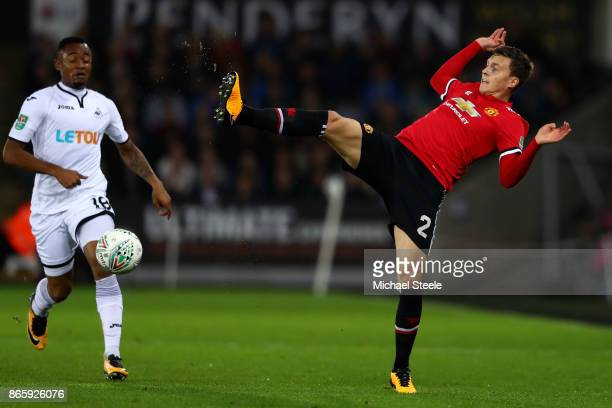 Jordan Ayew of Swansea City and Victor Lindelof of Manchester United in action during the Carabao Cup Fourth Round match between Swansea City and...