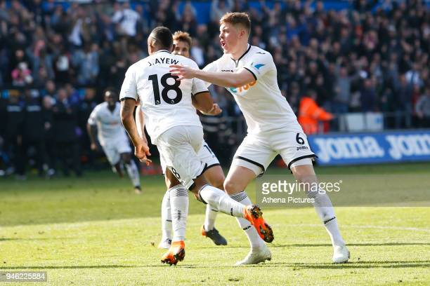 Jordan Ayew of Swansea City celebrates his goal with team mate Alfie Mawson of during the Premier League match between Swansea City and Everton at...