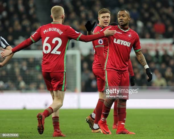 Jordan Ayew of Swansea City celebrates his goal with team mate Oliver McBurnie of Swansea City during the Premier League match between Newcastle...