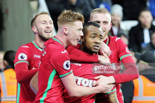 Jordan Ayew of Swansea City celebrates his goal with team mates Mike van der Hoorn Sam Clucas and Oliver McBurnie during the Premier League match...